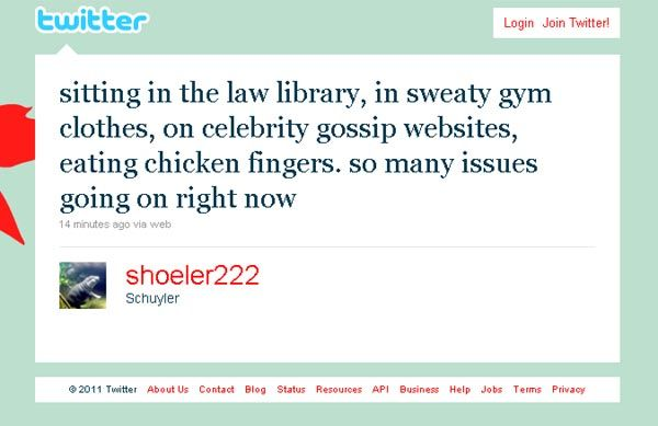 Law student in the law libry in sweaty gym clother browsing celebrity gossip sites